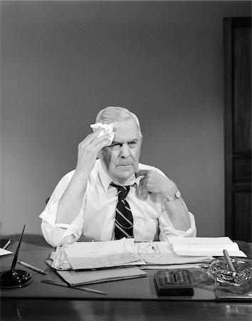 sweaty businessman - 1950s BUSINESSMAN SITTING AT DESK WIPING FOREHEAD WITH HANDKERCHIEF PULLING AT SHIRT COLLAR Stock Photo - Rights-Managed, Code: 846-05645869
