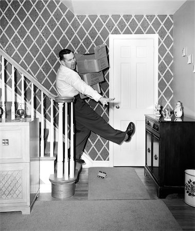1950s MAN CARRYING STORAGE BOXES DOWN STAIRS TRIPPING AND FALLING ON TOY ON FLOOR Stock Photo - Rights-Managed, Code: 846-05645860