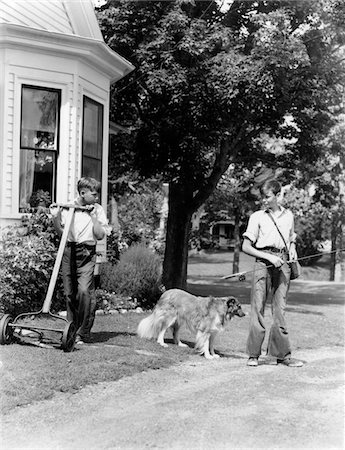 1940s BOY WITH FISHING GEAR COLLIE DOG SECOND BOY MOWING GRASS WITH PUSH MOWER Stock Photo - Rights-Managed, Code: 846-05645906