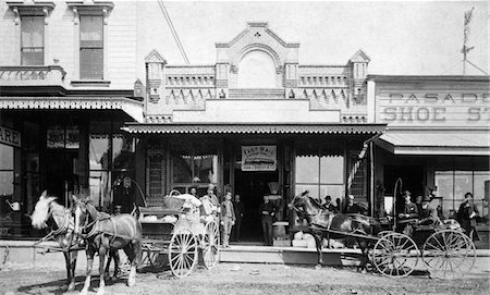 1880s - 1885 GROUPS OF MEN STANDING NEXT TO HORSE DRAWN CARRIAGES BUGGIES IN FRONT OF SHOPS ON NORTH SIDE OF COLORADO STREET PASADENA CALIFORNIA USA Stock Photo - Rights-Managed, Code: 846-05645917