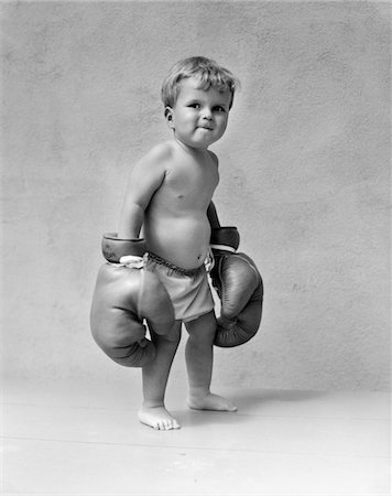 1930s BABY BOY TODDLER WEARING OVERSIZE BOXING GLOVES Stock Photo - Rights-Managed, Code: 846-05645930