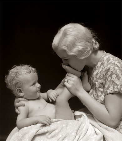 1930s MOTHER KISSING BOTTOM OF BABY'S FOOT Stock Photo - Rights-Managed, Code: 846-05645960