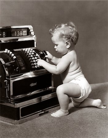 1930s - 1940s SALESPERSON BABY WEARING DIAPER RINGING UP SALE ON CASH REGISTER Stock Photo - Rights-Managed, Code: 846-05645989