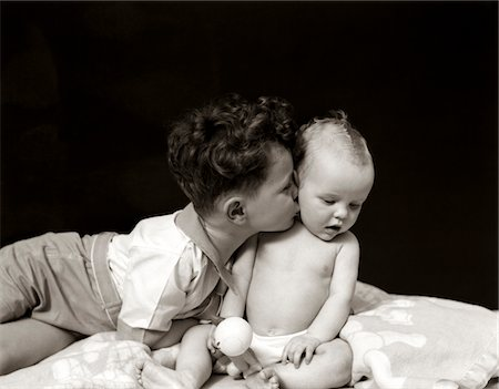 1940s CURLY HAIRED BOY TODDLER LEANING AND KISSING CUTE BABY Stock Photo - Rights-Managed, Code: 846-05645994