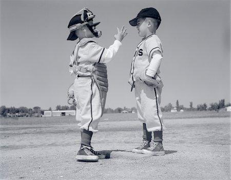 simsearch:846-02793283,k - 1960s BOY LITTLE LEAGUER PITCHER ARGUING WITH CATCHER Stock Photo - Rights-Managed, Code: 846-05646067