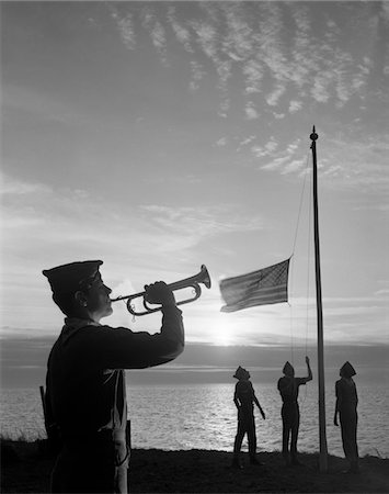 silhouette musical symbols - 1960s BOY SCOUTS AT CAMP SUNSET LOWER AMERICAN FLAG BUGLE TAPS 4 BOYS UNIFORM SILHOUETTED Stock Photo - Rights-Managed, Code: 846-05646060