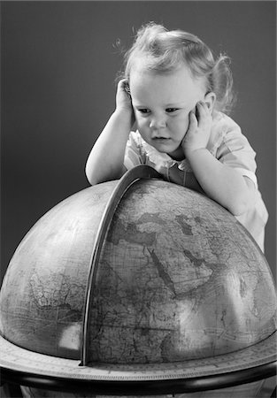 1940s BABY LOOKING AT LEANING ON GLOBE OF EARTH Stock Photo - Rights-Managed, Code: 846-05646108