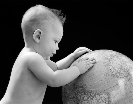 1940s BABY WITH HANDS ON GLOBE LOOKING AT THE EARTH Stock Photo - Rights-Managed, Code: 846-05646118