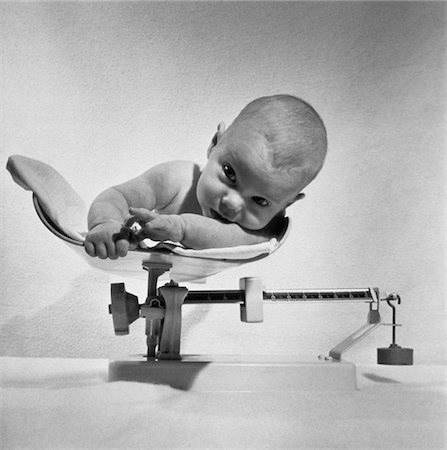 1940s - 1950S BABY LYING ON SCALE BEING WEIGHED Stock Photo - Rights-Managed, Code: 846-05646154
