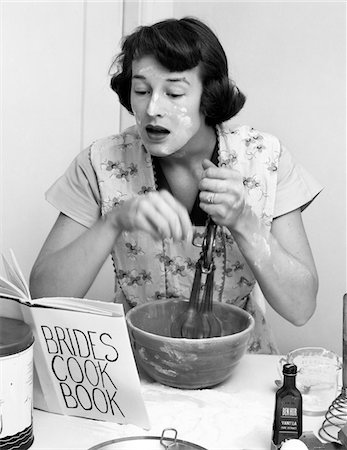 simsearch:846-02793283,k - 1950s WOMAN FACE COVERED FLOUR MIXING INGREDIENTS READING BRIDES COOK BOOK Stock Photo - Rights-Managed, Code: 846-05646159