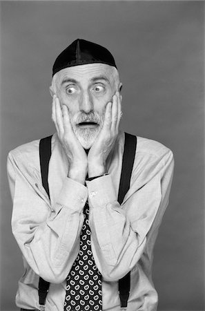 1990s PORTRAIT JEWISH MAN GRAY BEARD WEARING YARMULKE BOTH HANDS ON FACE FUNNY EXPRESSION OY VEY SHOCK FEAR WORRY DESPAIR Stock Photo - Rights-Managed, Code: 846-05646185