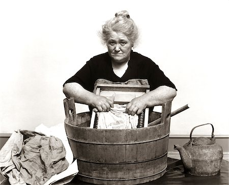 1920s - 1930s - 1940s SENIOR WOMAN WASHING CLOTHES IN OLD FASHIONED WOODEN TUB AND WASHBOARD Stock Photo - Rights-Managed, Code: 846-05646188