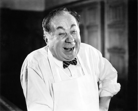 1930s - 1940s LAUGHING MAN PORTRAIT WEARING APRON BUTCHER BAKER GROCERY CLERK SERVICE HAPPY MAN Stock Photo - Rights-Managed, Code: 846-05646194