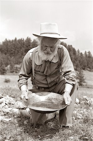 1950s MALE PROSPECTOR PANNING FOR GOLD Stock Photo - Rights-Managed, Code: 846-05646203