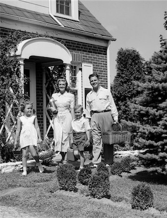 1940s - 1950s FAMILY OF FOUR WALKING OUT OF HOUSE CARRYING PICNIC BASKETS THERMOS & JUG Stock Photo - Rights-Managed, Code: 846-05646225