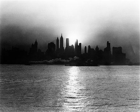 1930s - 1940s EARLY MORNING MISTY SUNRISE NEW YORK CITY WITH TUG BOAT BARGE IN HUDSON RIVER Stock Photo - Rights-Managed, Code: 846-05646253