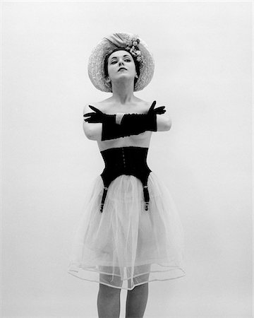 1950s WOMAN TOPLESS WEARING STRAW HAT LONG GLOVES BLACK GARTER BELT ARMS FOLDED IN FRONT Stock Photo - Rights-Managed, Code: 846-05646365