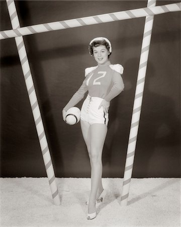 erotic female figures - 1950s - 1960s WOMAN IN SEXY FOOTBALL COSTUME AT GOALPOST Stock Photo - Rights-Managed, Code: 846-05646400