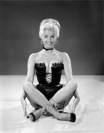 erotic female figures - 1960s BLONDE CHEESECAKE PORTRAIT OF WOMAN WEARING BLACK CAMISOLE CORSET AND FISHNET STOCKINGS Stock Photo - Rights-Managed, Code: 846-05646401