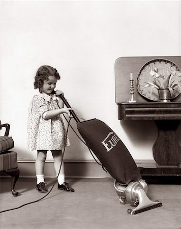 1930s LITTLE GIRL VACUUMING WITH EUREKA ELECTRIC VACUUM CLEANER Stock Photo - Rights-Managed, Code: 846-05646542