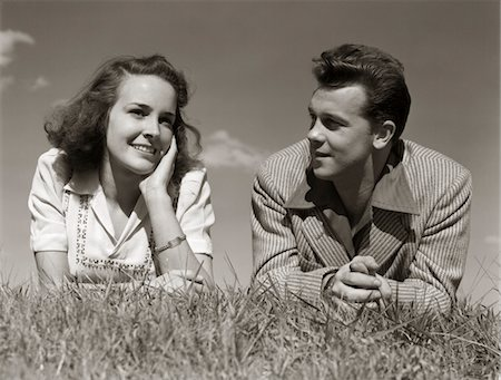 1940s TEENAGE COUPLE LYING IN GRASS ROMANCE BOY GIRL OUTDOOR Stock Photo - Rights-Managed, Code: 846-05646558