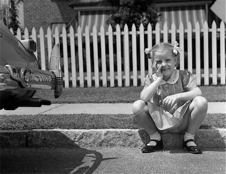 1940s GIRL SITTING ON CURB WITH TOOTH TIED TO BACK OF CAR FENDER Stock Photo - Rights-Managed, Code: 846-05646569