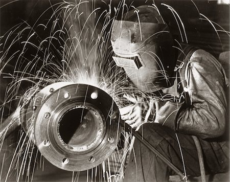 1950s MAN INDUSTRIAL WELDER WELDING PIPE WEARING PROTECTIVE MASK Stock Photo - Rights-Managed, Code: 846-05646584
