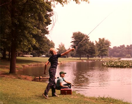 1960s - 1970s BOYS FISHING CASTING CASTING INTO POND Stock Photo - Rights-Managed, Code: 846-05646592