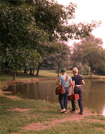 1970s TWO BOYS WALKING BESIDE POND CARRYING FISHING POLES AND TACKLE Stock Photo - Rights-Managed, Code: 846-05646593
