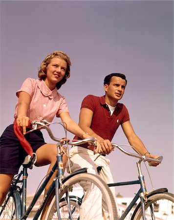 1950s - 1960s COUPLE MAN WOMAN Riding BICYCLES OUTDOORS Stock Photo - Rights-Managed, Code: 846-05646642