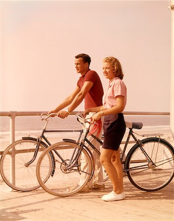 1950s - 1960s TEEN COUPLE STANDING BY BIKES ON  BEACH BOARDWALK Stock Photo - Rights-Managed, Code: 846-05646643