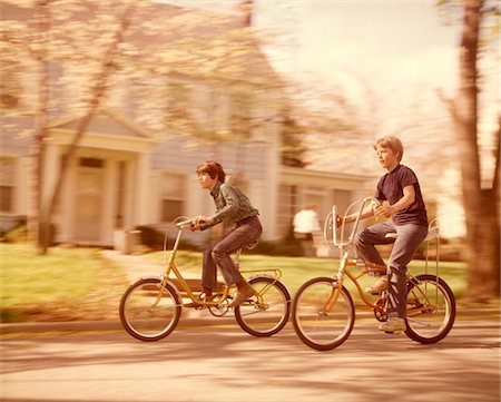 1970s BOYS RIDING BIKES  ON SUBURBAN STREET SPRINGTIME Stock Photo - Rights-Managed, Code: 846-05646714