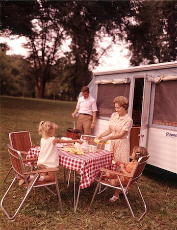 1960s FAMILY RV CAMPING FATHER GRILLING MOTHER  AND GIRLS SETTING TABLE Stock Photo - Rights-Managed, Code: 846-05646760