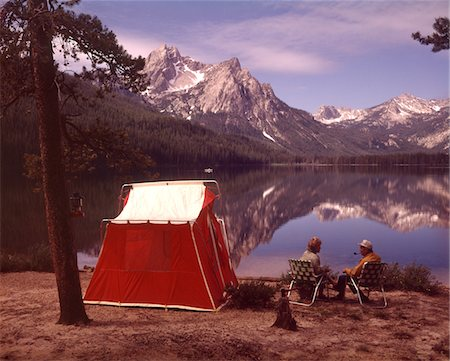 1970s OLDER COUPLE SITTING CAMPING BY RED TENT STANLEY LAKE IDAHO Stock Photo - Rights-Managed, Code: 846-05646780