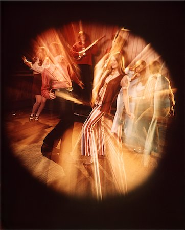 1960s - 1970s TEEN COUPLE DANCING ROCK BAND MUSIC BANDS BLURRED CIRCULAR VIGNETTE Stock Photo - Rights-Managed, Code: 846-05646797