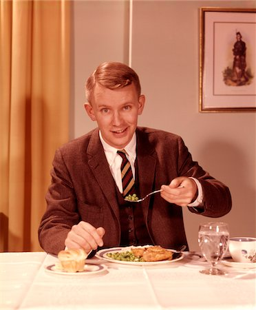 1960s SMILING MAN EATING DINNER AT TABLE WITH FORK FULL OF PEAS Stock Photo - Rights-Managed, Code: 846-05646791