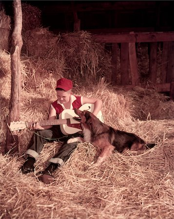 roll (people and animals rolling around) - 1950s BOY PLAYING GUITAR COLLIE DOG SITTING HAY BALES INSIDE BARN Stock Photo - Rights-Managed, Code: 846-05646827