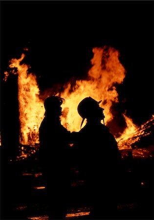 silhouette of firework - FIREMEN SILHOUETTED BY FIRE Stock Photo - Rights-Managed, Code: 846-05646856