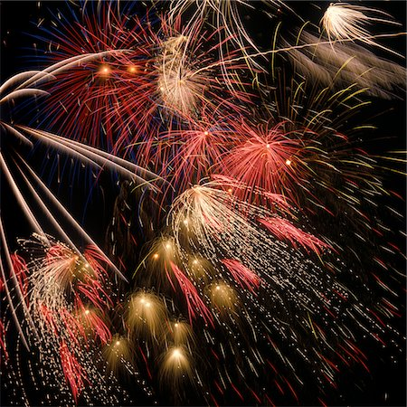 fun happy colorful background images - BURSTS OF FIREWORKS IN NIGHT SKY Stock Photo - Rights-Managed, Code: 846-05646877