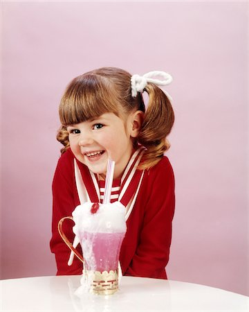 1960s - 19670s HAPPY LITTLE GIRL WITH ICE CREAM SODA STUDIO PONYTAIL Stock Photo - Rights-Managed, Code: 846-05646939