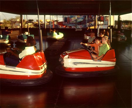 1970s CHILDREN BOYS GIRLS RIDING BUMPER CARS RIDE AT AMUSEMENT PARK Stock Photo - Rights-Managed, Code: 846-05646940