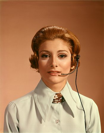 1960s - 1970s PORTRAIT WOMAN TELEPHONE OPERATOR RECEPTIONIST OFFICE WORKER WEARING HEADSET Stock Photo - Rights-Managed, Code: 846-05646961