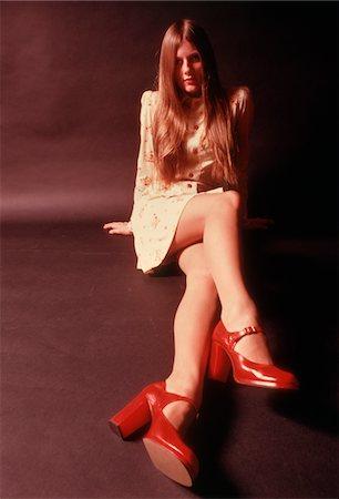 1970s WOMAN LONG AUBURN HAIR MINI SKIRT DRESS RED PLATFORM HIGH HEELED SHOES Stock Photo - Rights-Managed, Code: 846-05646988