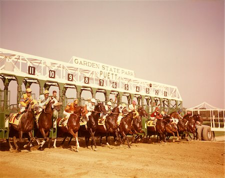 1960s ELEVEN RACE HORSES AND JOCKEYS COMING OUT OF STARTING GATE Stock Photo - Rights-Managed, Code: 846-05647011