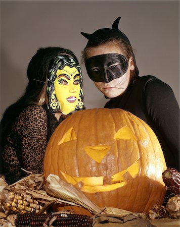 preteen girl pussy - TWO YOUNG GIRLS IN WITCH AND BLACK CAT HALLOWEEN COSTUMES WITH CARVED JACK-O-LANTERN PUMPKIN S Stock Photo - Rights-Managed, Code: 846-05647012