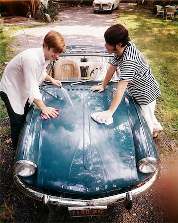 1970s TWO TEENAGED BOYS WASHING TRIUMPH SPORTS CAR  CONVERTIBLE Stock Photo - Rights-Managed, Code: 846-05647137