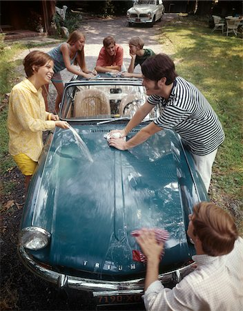 1970s TEENAGE GROUP OF 3 BOYS AND 3 GIRLS TOGETHER WASHING TRIUMPH SPITFIRE SPORTS CAR Stock Photo - Rights-Managed, Code: 846-05647138