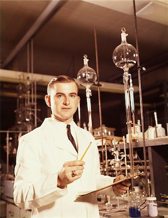 1960s SCIENTIST CONDUCTING A TITRATION EXPERIMENT Stock Photo - Rights-Managed, Code: 846-05647175