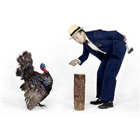 1930s - 1940s MAN CHARACTER WITH HATCHET TRYING TO CATCH A THANKSGIVING TURKEY Stock Photo - Rights-Managed, Code: 846-05647180
