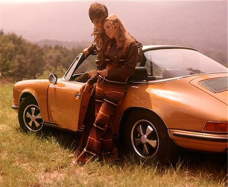 1970s STYLISHLY DRESSED COUPLE STANDING TOGETHER LEANING ON A CONVERTIBLE PORSCHE AUTOMOBILE SPORTS CAR Stock Photo - Rights-Managed, Code: 846-05647207